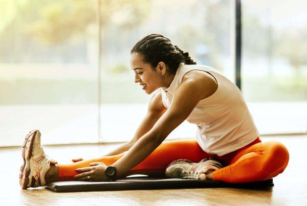 Health Goal Setting - A woman stretches her leg